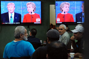 People watch the U.S. presidential debate in a restaurant in the Queens borough of New York City, September 26, 2016.