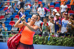 Petra Kvitova of the Czech Republic takes a photo with fans during the women's s...