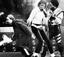 While Michael Jackson, center, and Brother Tito, right, perform during the Jacks...