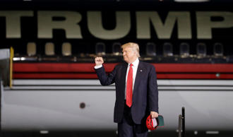 Republican presidential candidate Donald Trump arrives at a rally Tuesday, Sept....