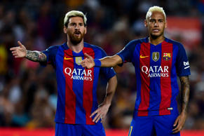 Lionel Messi (L) and Neymar Jr. of FC Barcelona reacts during the La Liga match between FC Barcelona and Deportivo Alaves at Camp Nou stadium on Sept. 10.