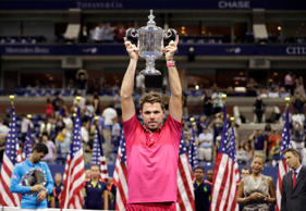 Stan Wawrinka, of Switzerland, holds up the championship trophy after beating Novak Djokovic, of Serbia, to win the men's singles final of the U.S. Open tennis tournament on Sept. 11.