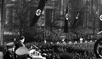Adolf Hitler, lower left, addresses 25,000 stormtroopers from an improvised rostrum on the steps of the Atlas Museum in the Lustgarten of Berlin, Germany, on the third anniversary of National Socialism's rise to power on Jan. 30, 1936. In his speech, Hitler reiterated Germany's will to peace. The Nazi Party leader was appointed Chancellor of Germany on Jan. 30, 1933. (AP Photo)