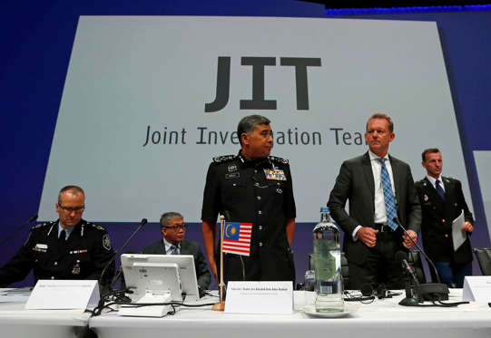 The Joint Investigation Team take their seats for a press conference on the preliminary results of the investigation into the shooting-down of Malaysia Airlines flight MH17 during a press conference in Nieuwegein, Netherlands, on Sept. 28.
