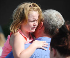Lilly Chapman, 8, cries after being reunited with her father, John Chapman at Oa...