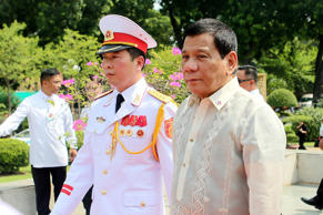 Philippine President Rodrigo Duterte, right, attends a wreath laying ceremony at the Monument of National Heroes and Martyrs in Hanoi, Vietnam, Thursday, Sept. 29, 2016.