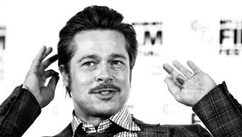 LONDON, ENGLAND - OCTOBER 19:  (EDITORS NOTE: Image has been converted to black and white.) An alternative view of Brad Pitt during the Fury Press Conference at The Corinthia Hotel during The 58th London Film Festival on October 19, 2014 in London, Engla