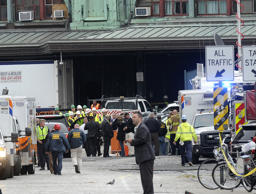 New Jersey Gov. Chris Christie, left, arrives at the scene of a train accident at the Hoboken Terminal Thursday, Sept. 29, 2016 in Hoboken, N.J.