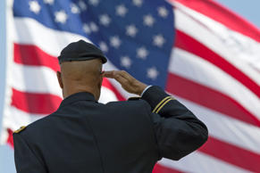 Retired Milton S Herring saluting the US flag at Los Angeles National Cemetery A...