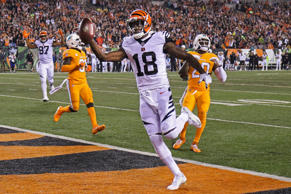 Cincinnati Bengals wide receiver A.J. Green (18) scores a touchdown during the first half of an NFL football game against the Miami Dolphins, Thursday, Sept. 29, 2016, in Cincinnati.