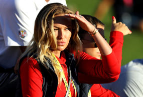 Paulina Gretzky, partner of Dustin Johnson of the United States, looks on during...