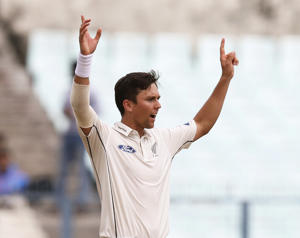 Trent Boult celebrates after taking the wicket of Indian batsman Mohammed Shami
