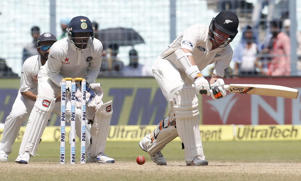 Tom Latham (R) plays a shot as India's wicketkeeper Wriddhiman Saha and Ajinkya Rahane look on