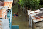 Picture taken in the flooded neighbourhood of La Puya, in Santo Domingo on October 4, 2016 after the passage of Hurricane Matthew through Hispaniola -- the island that the Dominican Republic shares with Haiti. Matthew, a Category Four hurricane, slammed into the Dominican Republic and Haiti Tuesday, triggering major floods and forcing thousands to flee the path of the storm that has claimed at least three lives in each country.