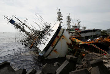 A partially capsized fishing ship is seen after Typhoon Meranti made landfall, in Kaohsiung, Taiwan, on Thursday.