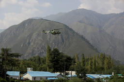 An Indian army helicopter flies above the army base which was attacked by militants in Uri on September 18, 2016.