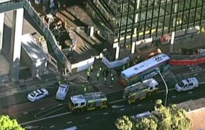 The bus clipped the excavator on Smith Street in Parramatta just before 7am