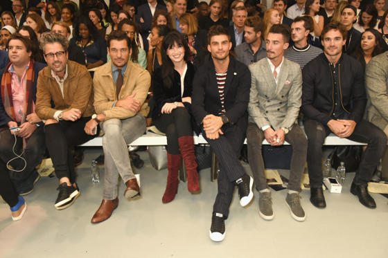Slide 1 of 48: LONDON, ENGLAND - SEPTEMBER 20:  (From 2nd L) Larry King, David Gandy, Daisy Lowe, Aljaz Skorjanec, Struan Moore and Thom Evans sit on the front row at Vero X Oliver Spencer Catwalk Show, witnessing the first instant See Now, Buy Now purchase on new soci