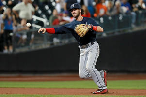 Dansby Swanson #2 of the Atlanta Braves throws out a runner at first base in the eighth inning of the game against the New York Mets on September 20, 2016 at Citi Field in the Flushing neighborhood of the Queens borough of New York City.
