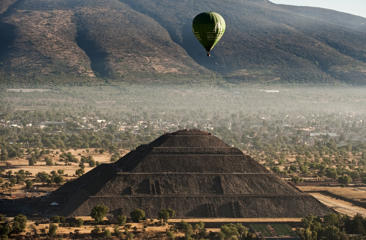 A hot air balloon flies over the Sun Pyramid at the Teotihuacan archaeological site during the Teotihuacan Hot Air Balloon Festival in San Juan de Teotihuacan, State of Mexico, on March 21, 2011. The festival is being held on the spring equinox.
