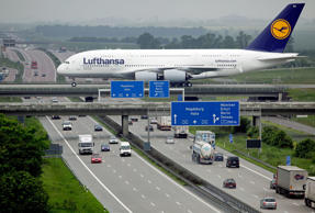 An Airbus A380 of German airline Lufthansa rolls over a bridge after it landed a...