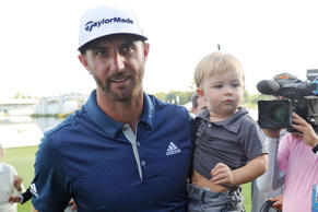 Sep 11, 2016; Carmel, IN, USA;  Dustin Johnson holds his son Tatum after winning the BMW Championship at Crooked Stick GC.
