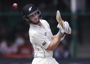 New Zealand's captain Kane Williamson bats on the second day of their cricket test match against India at Green Park stadium in Kanpur, India, Friday, Sept. 23, 2016.