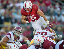 Christian McCaffrey #5 of the Stanford Cardinal dives over the top for no gain at the one yard line against the USC Trojans during the first half of their NCAA football game at Stanford Stadium on September 17, 2016 in Palo Alto, California.