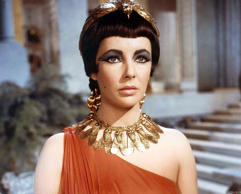 VARIOUS Elizabeth Taylor as Cleopatra; Rex Harrison and Richard Burton, in the 1963 epic drama film directed by Joseph L. Mankiewicz.