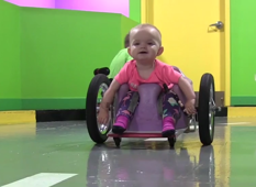 2016 in Review: Toddler steals hearts zipping around in wheelchair