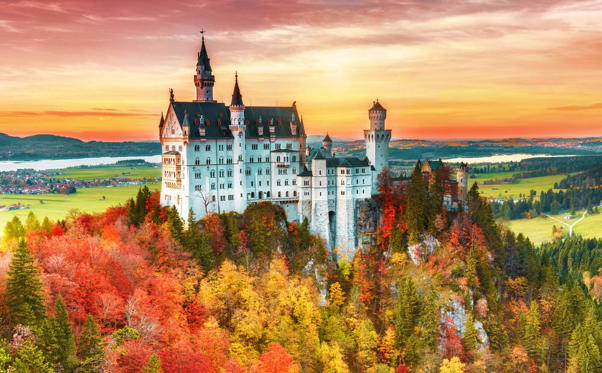Slide 1 of 34: Beautiful aurumn view of Neuschwanstein castle in autumn season. Palace situated in Bavaria, Germany. Neuschwanstein castle one of the most popular palace and travel destination in Europe and world.