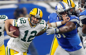 Green Bay Packers quarterback Aaron Rodgers (12) stiff arms Detroit Lions defensive tackle A'Shawn Robinson (91) during the second half of an NFL football game, Sunday, Jan. 1, 2017, in Detroit.