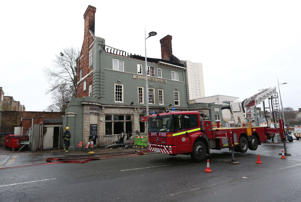 "A fire engine outside The Aeronaut pub in Acton, west London, where hundreds of New Year's Eve revellers were evacuated before it was largely ""gutted"" by a fire."