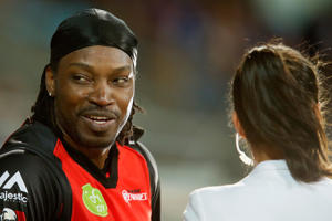 Chris Gayle of the Melbourne Renegades gives a TV interview to Mel Mclaughlin during the Big Bash League