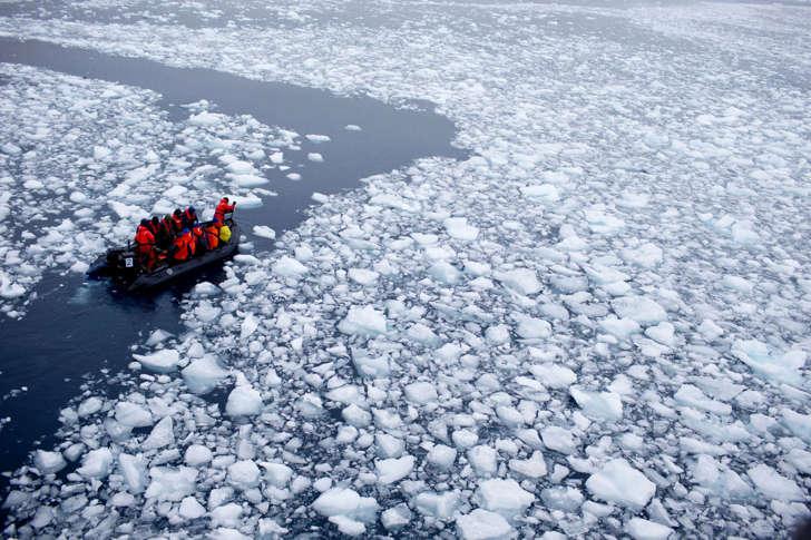 In this Jan. 22, 2015 photo, a zodiac carrying a team of international scientists heads to Bernardo O'Higgins, Antarctica.