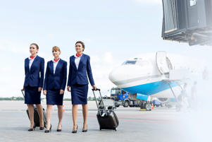 Stewardesses walking on airport runway