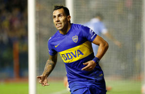 BUENOS AIRES, ARGENTINA - APRIL 07:  Carlos Tevez of Boca Juniors celebrates after scoring the second goal of his team during a match between Boca Juniors and Bolivar as part of Group 3 of Copa Bridgestone Libertadores 2016 at Alberto J Armando Stadium o