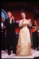 291964 10: (NO NEWSWEEK - NO USNEWS) President Bill Clinton and wife Hillary clap their hands at an inaugural ball January 20, 1997 in Washington, DC. Clinton attended various inaugural balls after his defeat of Bob Dole in the national presidential elec