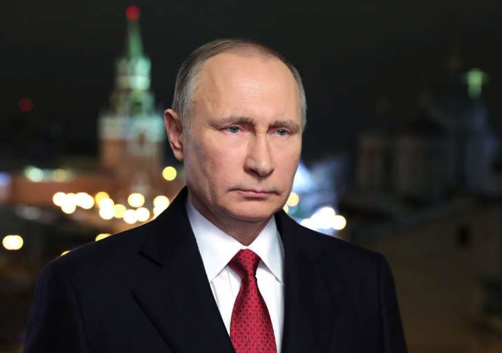 In this photo released by the Kremlin Press service via Sputnik agency, Saturday, Dec. 31, 2016, Russian President Vladimir Putin speaks during an undated recording of his annual televised New Year's message in the Kremlin in Moscow, Russia.