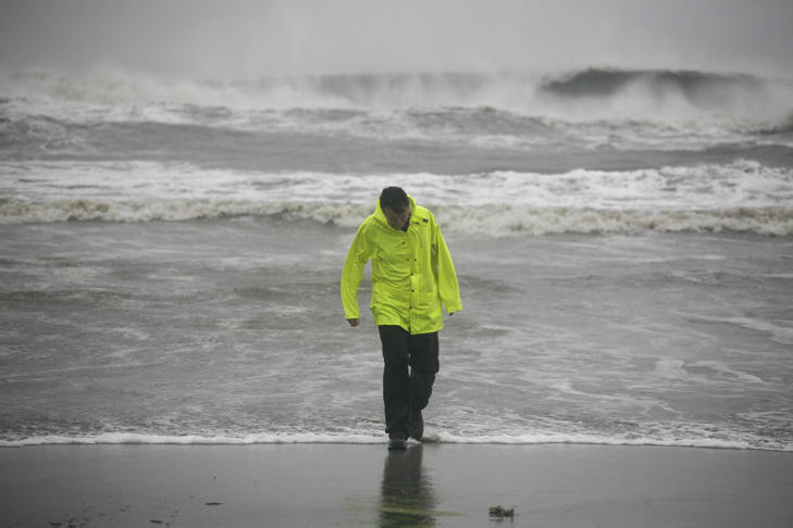 David Reedy braves the wind and rain on the Isle of Palms beach as Hurricane Matthew hits the Isle of Palms, S.C., Saturday, October 8, 2016.
