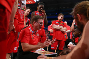 Trevor Gleeson, coach of the Wildcats addresses his players at a time-out during the round one NBL match between the Perth Wildcats and the Cairns Taipans at Perth Arena on October 8, 2016 in Perth, Australia.