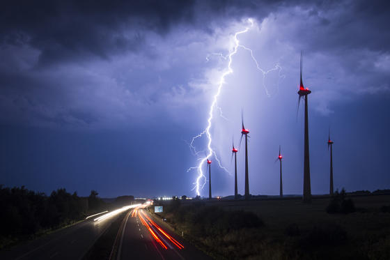 GOERLITZ, GERMANY - AUGUST 28: Lightning strikes behind wind turbines during a thunderstorm near the border between Germany and Poland on August 28, 2016 in Goerlitz, Germany. After a hot weekend across Germany, the weather is cooling down. (Photo by Flo