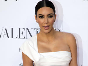 Kim Kardashian sues over claims she faked Paris robbery