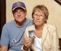 FILE - In this Aug. 28, 2009, file photo, Patty and Jerry Wetterling show a photo of their son Jacob Wetterling.