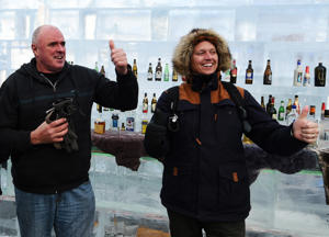 Two Australian tourists gives a thumb up in an ice bar in Harbin, capital of northeast China's Heilongjiang Province