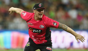 Jason Roy of the Sixers celebrates taking he catch to dismiss Ben Rohrer of the Thunder during the Big Bash League match between the Sydney Thunder and the Sydney Sixers at Spotless Stadium.