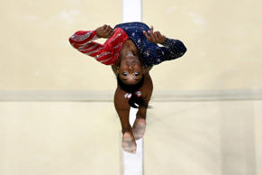 RIO DE JANEIRO, BRAZIL - AUGUST 07:  Simone Biles of the United States competes on the balance beam during Women's qualification for Artistic Gymnastics on Day 2 of the Rio 2016 Olympic Games at the Rio Olympic Arena on August 7, 2016 in Rio de Janeiro,