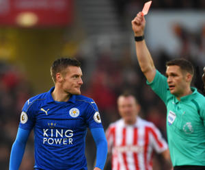 Jamie Vardy of Leicester City (L) is shown a red card by referee Craig Pawson during the Premier League match between Stoke City and Leicester City at Bet365 Stadium.