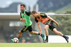 Tom Doyle holds off the challenge of Jacob Tratt during a Wellington Phoenix training session on December 7, 2016.