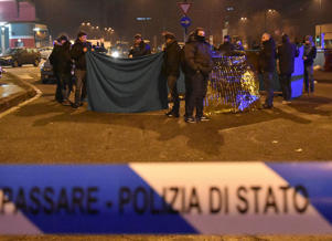 Italian Police officers work next to the body of Anis Amri, the suspect in the Berlin Christmas market truck attack, in a suburb of the northern Italian city of Milan, Italy December 23, 2016.
